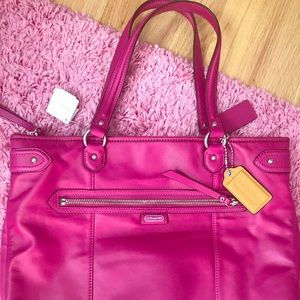 New with tags pink leather coach purse.